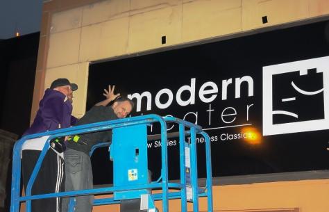 george on ladder - new sign - sandra hosking - the modern